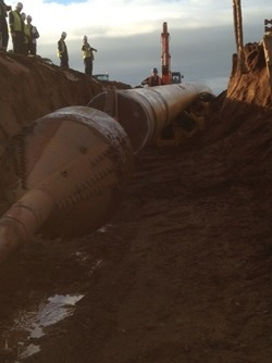 36 inch steel pipe being pulled into position ready for installation