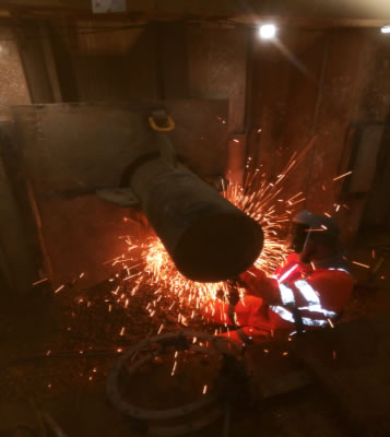 Steel casing pipe being welded prior to ramming